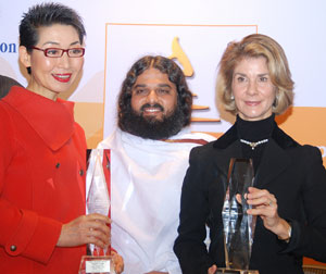 (Left to Right) Ms. Kim, winner of Ethics in Business Award; Swami Pragyapad, International Faculty the Art of Living; Ms. Brigitte Mohan, winner of Outstanding Individual Award